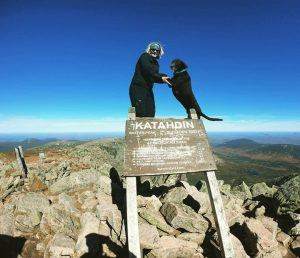 fake photo of girl and dog at the top of katahin